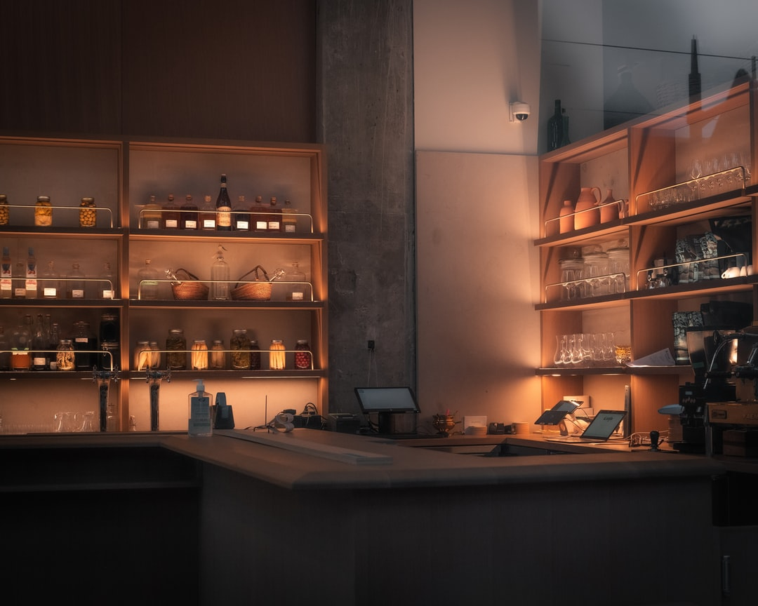A kitchen that is lit up at night