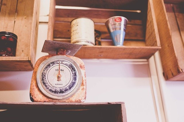 A clock sitting on top of a wooden table